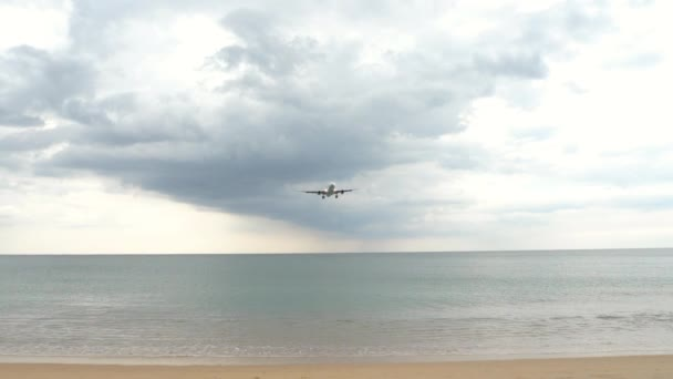Airplane approaching over ocean