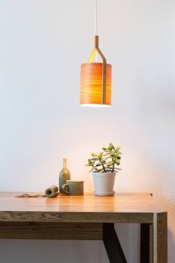 turn on wooden lamp over the table