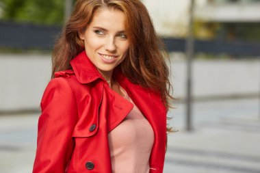 Beautiful stylish woman in a red coat.