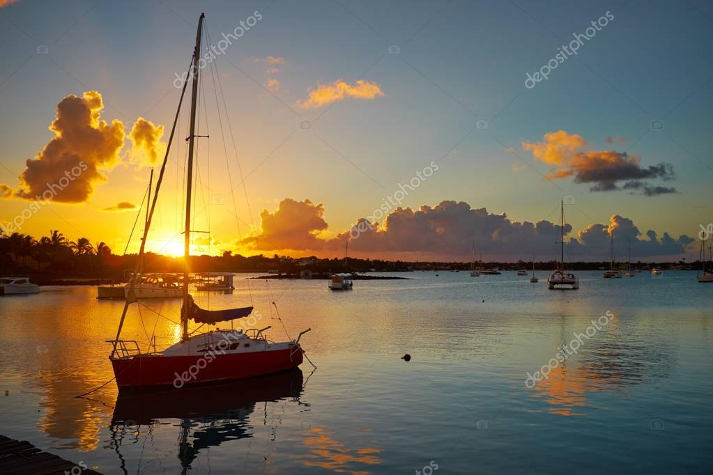 Fishing boats on the background of incredible golden sunset