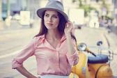Fotografie Modisch gekleidete Frau