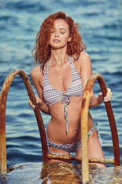 redhair woman in bikini
