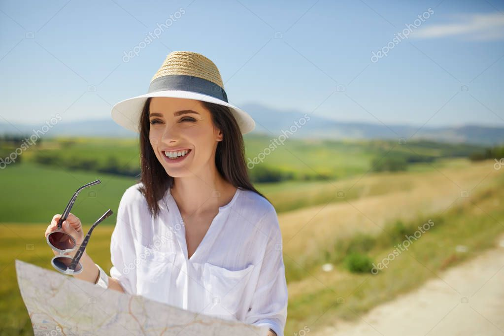 Woman holding paper map finding right tourist route stock vector