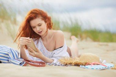 Beautiful happy girl, talking  on phone on a  sea coast stock vector