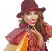 Herbstfrau mit Einkaufstüten. Studiodreh