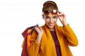 Fotografie Herbstfrau mit Einkaufstüten. Studiodreh