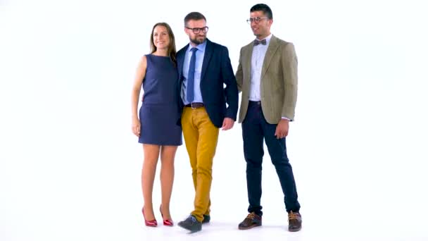 Group of three business partners posing in studio for camera