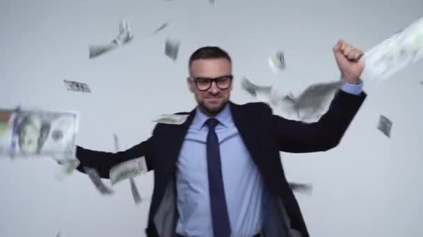 Slow Motion Of Dollars Falling On Formally Dressed Man Stock Video