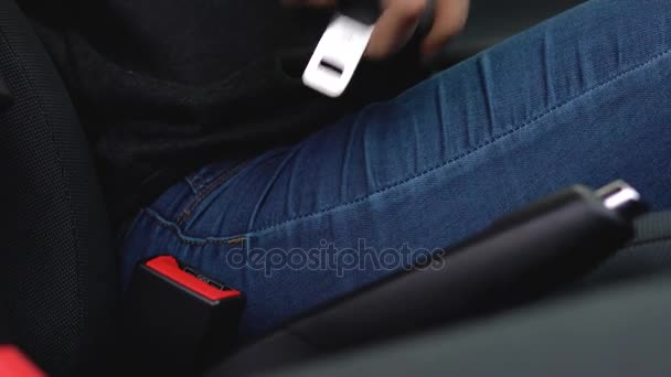 Female hand fastening car safety seat belt while sitting inside of ...