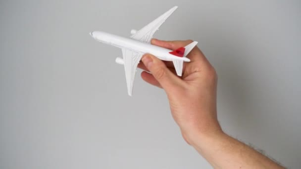 Toy airplane in the hand simulates a flight