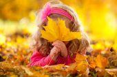 Happy girl in autumn park