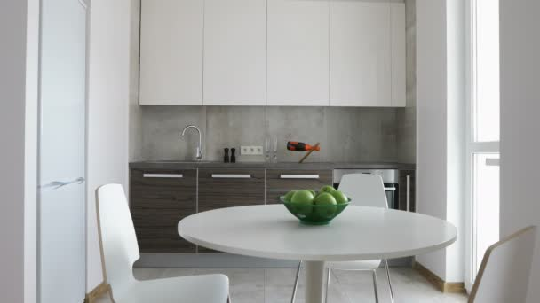 4K. Interior of modern kitchen in scandinavian style. Motion panoramic view.