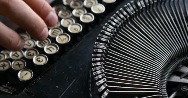 Old Typewriter Typing. Vintage. typewriter being used by male hands seen from the side, using only index fingers pecking keys.