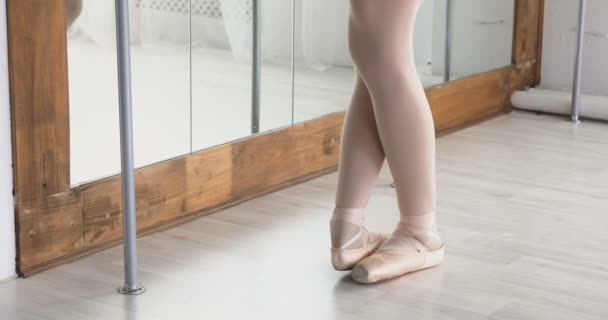 Close-up of ballerina feet in pointe shoes dancing ballet elements