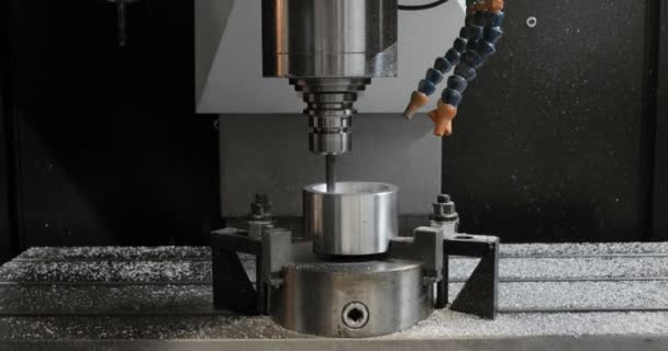 CNC Milling Machine Produces Metal Detail on Factory.