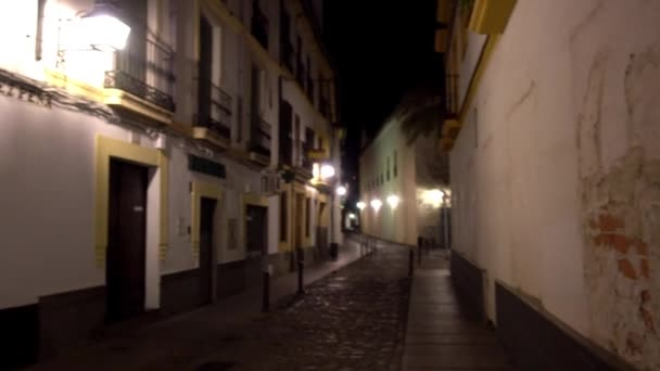 Old houses on dark evening in Cordoba, Andalusia, Spain.