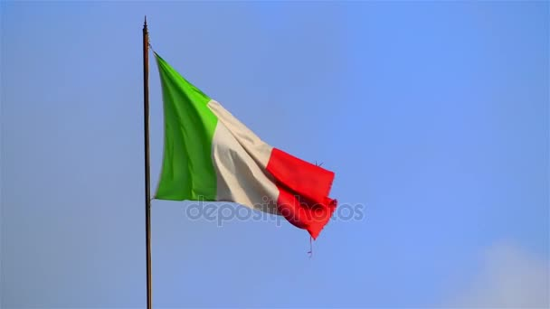 national flag of Italy waving in wind against blue sky