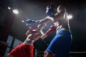 Photo Fighting in boxing ring