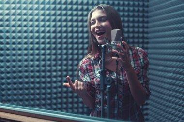 Woman singing indoors