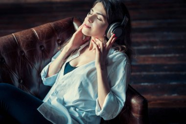 Young pretty woman with headphones indoors