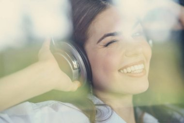 Pretty young girl listen to music on headphones