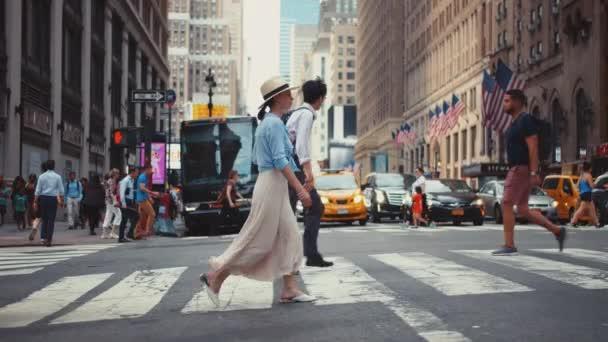 Young girl crossing a crosswalk in Manhattan in New York