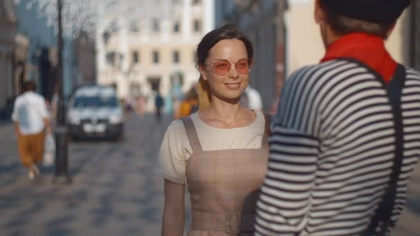 Young girl talking with mime on the street