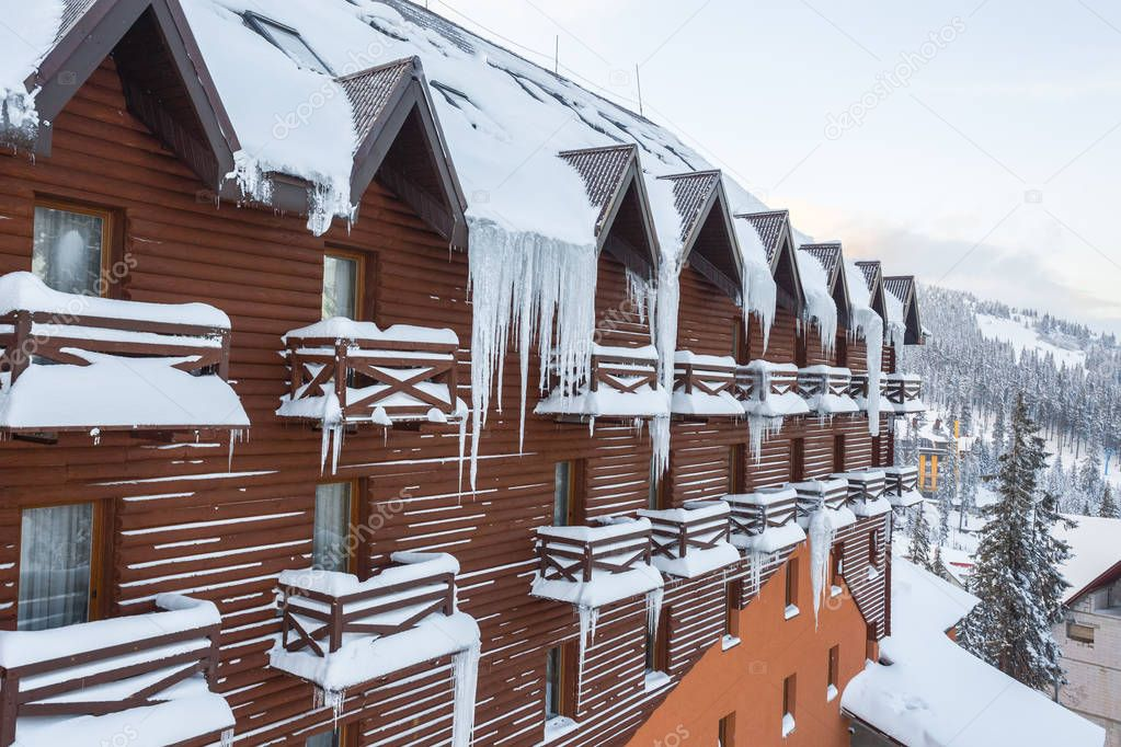 Many icicles at a roof