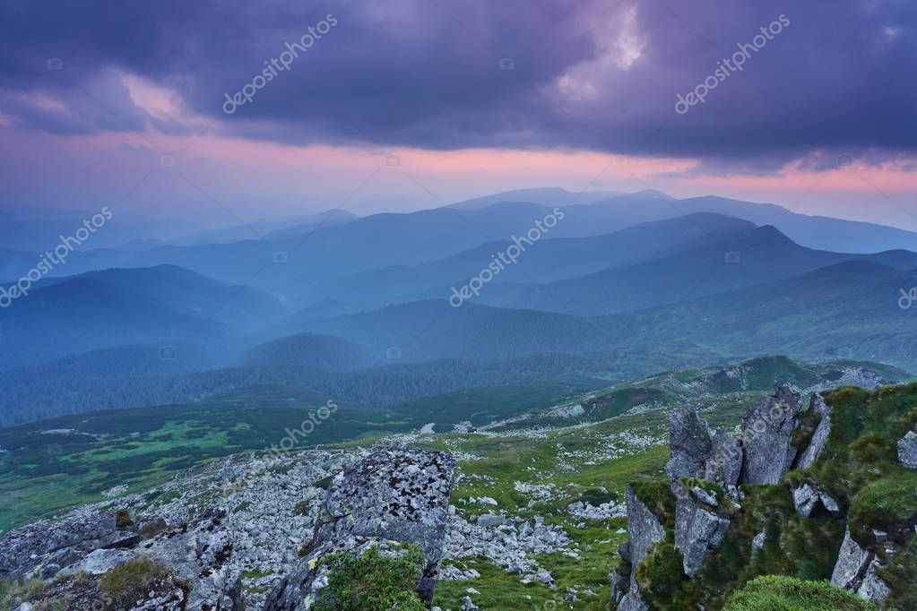 summer landscape in the mountains with the sun at dawn
