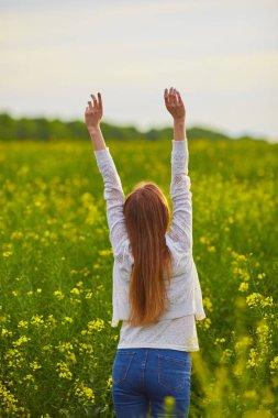 Joyful girl at yellow rape seed meadow stock vector