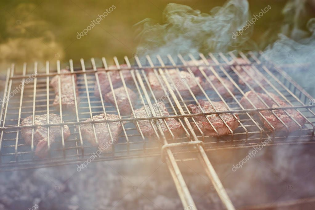 Top sirloin steak on a barbecue, shallow depth of field. Summer