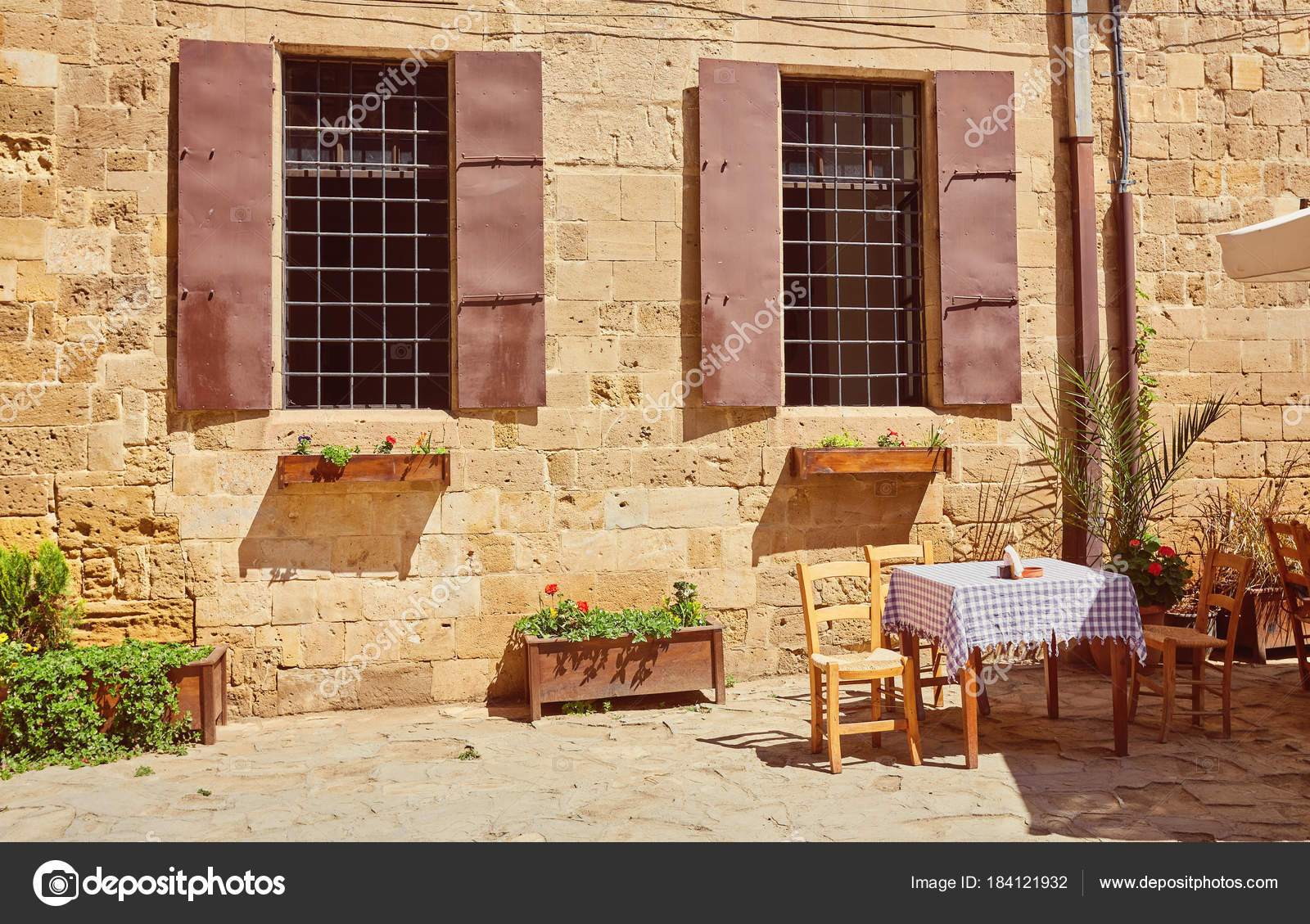 yellow shutters window and door — Stock Photo © saharrr #184121932