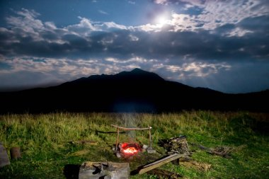 Campfire near mountain