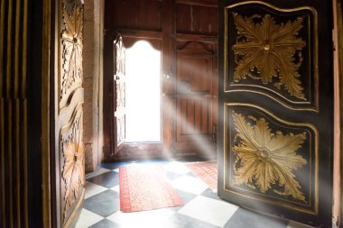 Light rays from the old wooden door