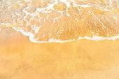 Tengerparti homok és óceán hullám