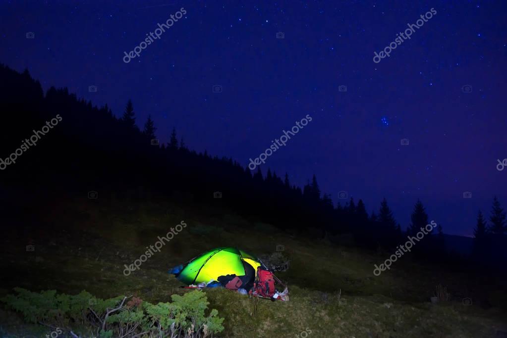 Illuminated orange camping tent