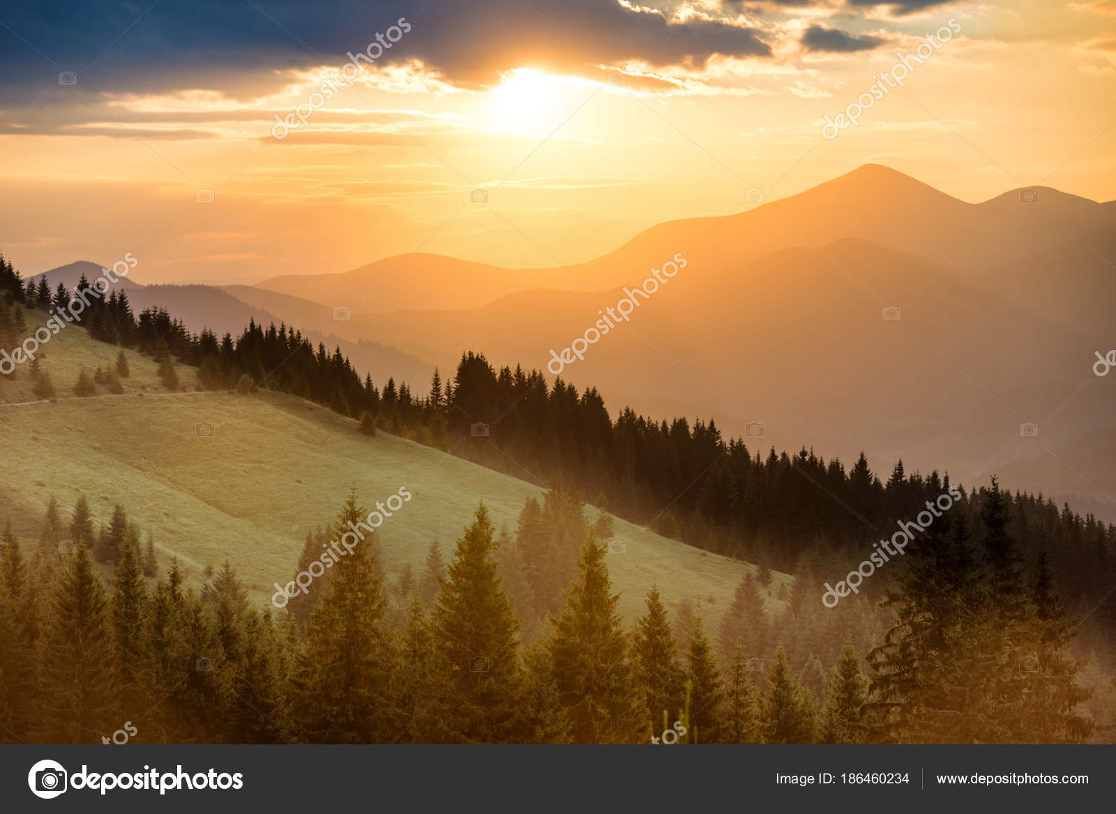 Beautiful Dramatic Sunset In The Mountains Landscape With Sun Shining Through Orange Clouds Photo By Dovapi