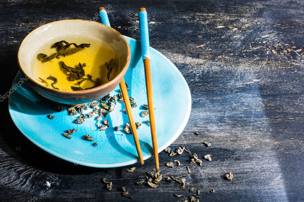 Image result for green tea on blue wooden table