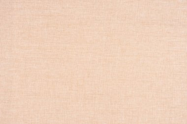 close up of a woolen fabric of beige color. Abstract background,