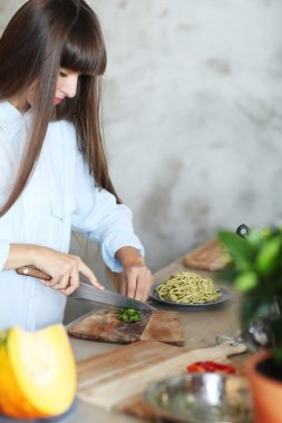 Girl cutting parsley