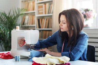 seamstress working on sewing machine