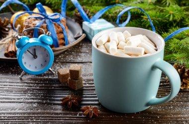 Christmas background of blue hot chocolate mug with marshmallows