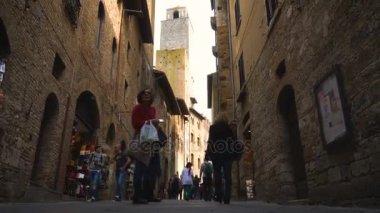 TUSCANY, ITALY - APRIL 04, 2017:  people on the streets of San Gimignano Tuscany Italy at April 04, 2017