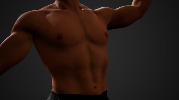 Schöner muskulöser, hemdloser junger Mann, der im Dunkeln steht