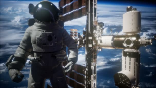 International Space Station and astronaut in outer space over the planet Earth