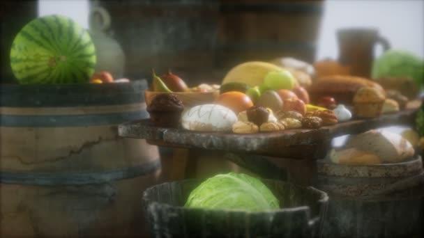jídelní stůl s vinnými sudy a ovocem, zeleninou a chlebem