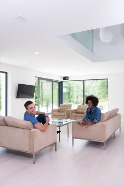 multiethnic couple in living room