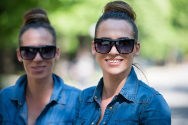 twin sisters with sunglasses