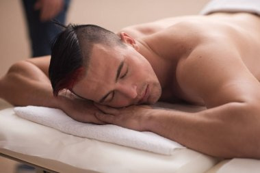 Man resting in spa massage center