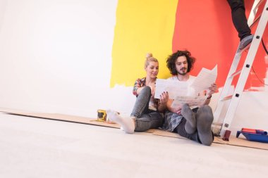 Happy couple relaxing after painting